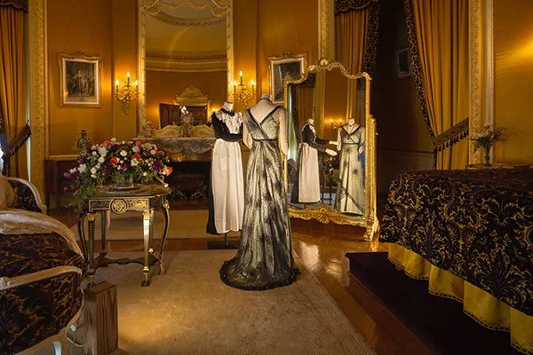 In Edith Vanderbilt's bedroom, Lady Mary Crawley is being dressed by her lady's maid. This evening dress was worn at dinner for Matthew Crawley's arrival at Downton Abbey. Photo Credit: The Biltmore Company