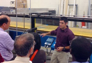 Lab manager Achilleas Tsakiris explains one of the functions of the lab's main flumes to visitors during the open house.