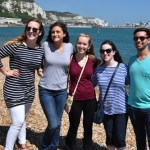Chamber singers Heather Gamble, Haley Retterer, Ashton Brooke, Rachel Brown, and Taylor Stone on the edge of the English Channel with the White Cliffs of Dover in the background.
