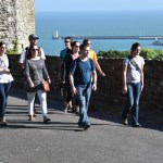 Chamber Singers walk atop Dover Castle.