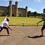 Chamber Singers Jordan Cross, left, and Evan Headrick engage in a friendly sword fight in front of Leeds Castle.