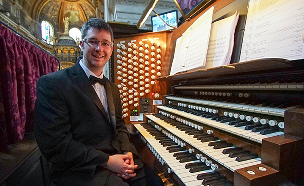 Chamber Singer Simon Hogg sits at the organ inside Saint Paul's Cathedral in London.