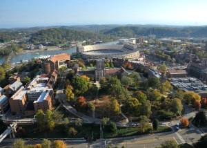 Aerial photograph of the University of Tennessee hill, with Ayres Hall. Leyland Stadium and the Tennessee River are visible in the background.