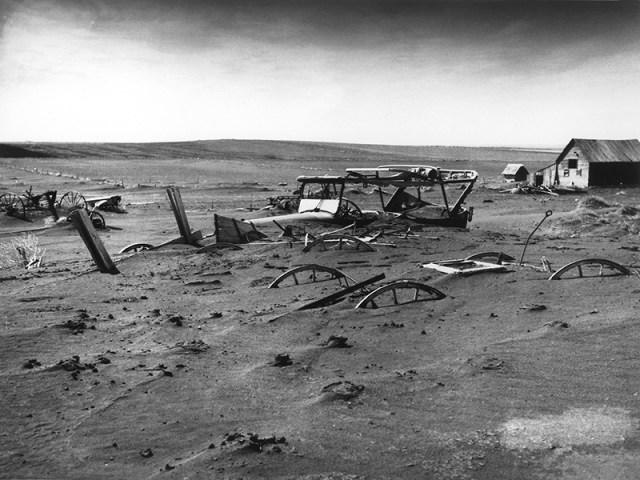"This iconic photo taken by the U.S. Department of Agriculture and now in the public domain shows a farm in Dallas, South Dakota on May 13, 1936 after a ""Dust Bowl"" storm covered soil and equipment in a layer of dust. After decades of teaching students that the era ended with new farming techniques in the 1940s, a study led by the University of Tennessee and University of Illinois has shown that soil quality actually continued to decline until the 1980s and even now isn't back to the level it was in the mid-1930s."