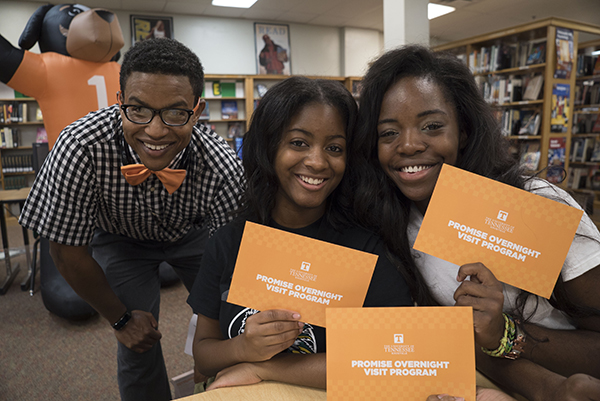 Memphis Central High School students pose with their admissions envelopes with Charlie Folsom, UT admissions counselor.