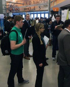 Students from the College of Engineering wait in lines to speak with companies about possible paid internship and paid co-op opportunities during the 2016 Engineering Expo at Thompson-Boling Arena.