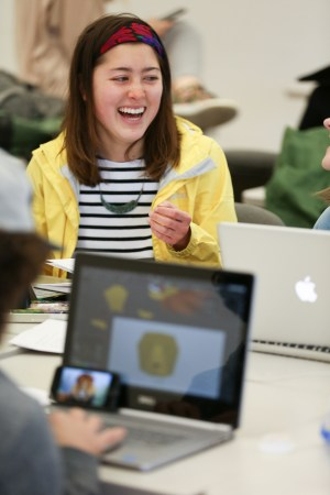 Students and teachers in a motion workshop learning how to animate animals they create in After Effects. Photo by Adam Taylor