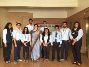 Professor Sumita Joshi along with students from Pune, India, and P&G representatives.