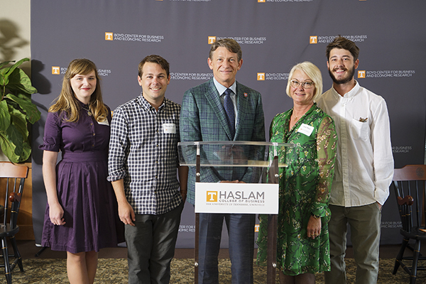 Randy Boyd (center) and his wife, Jenny (second from right), pose for a photograph with their sons, Thomas Boyd and his wife Lindsey (far left), and Harrison (far right