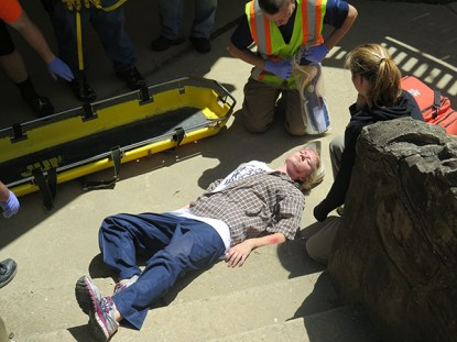 Kaitlyn Hillstead, junior, acts as a simulated victim for full-scale disaster readiness drill in Clay County, Kentucky.