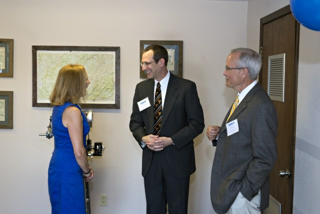 Department of Industrial and Systems Engineering head John Kobza, middle, meets with officials from Dunlap Industries.