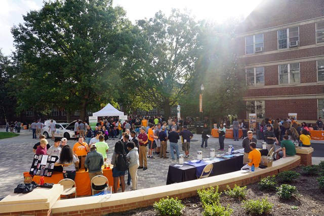 Students visit various booths on the quad between Perkins and Ferris Halls as part of Engineers Day 2016. More than 1,700 students from around the state were expected.