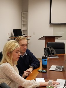 Communication Studies Seniors Morgan Kahle and Jack Wimbish prepare for the capstone project presentation in the Public Speaking Center.