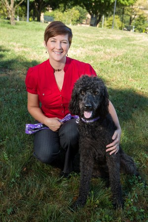 "Taylor Opel with her three-year-old ""schnoodle"" Raven, a poodle and schnauzer mix. Opel is a veteran and a veterinarian."