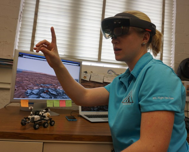 Rachel Kronyak demonstrates the use of the HoloLens. The image she sees in 3-D is displayed on the computer screen.