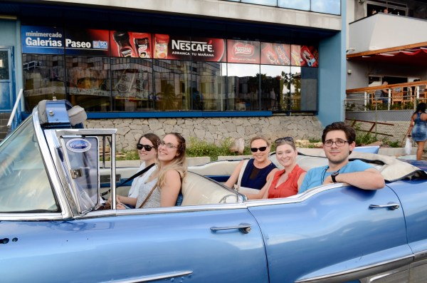 From left to right, freshmen Sarah Tanner and Madison Blackburn; (back seat left to right) Kelly Hewett, associate professor of marketing and supply chain; Sara Easler, Haslam College of Business director of international programs and study abroad; and freshman Jonathan Rumley ride in a vintage car in Havana.