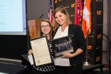 Miranda Rutan, left, is presented with a resolution by student trustee Rachel Smith, right, honoring her time as a student trustee during a University of Tennessee Board of Trustees meeting in Hollingsworth Auditorium at the UT Institute of Agriculture in Knoxville, Tenn., Thursday, June 22, 2017. (Adam Brimer / University of Tennessee)