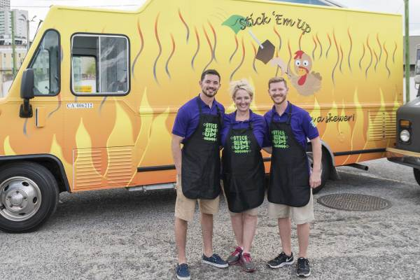 Justin, Shona, and Landon House in front of their food truck.