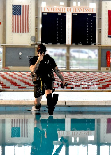 Navy Veteran, and former  Navy Diver Alex Weber diving in the student Aquatic ctr diving well.