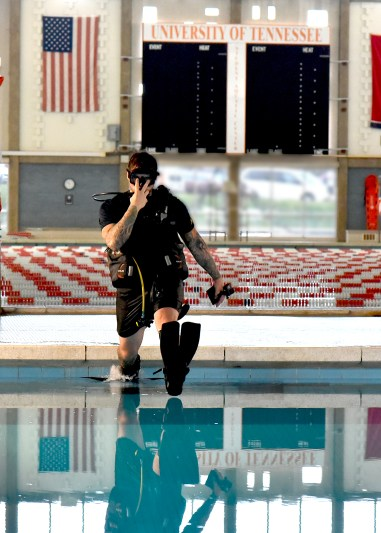 Navy Veteran, and former Navy Diver Alex Weber dives in the student Aquatic Center diving well.