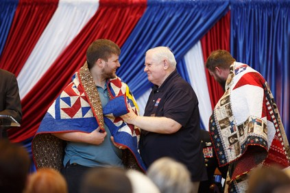 Brandon Pendergrass of Ten Mile, Tennessee, a senior studying psychology, receives a Quilt of Valor on November 17. Pendergrass wants to work with veterans as a mental health professional.