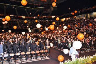 Balloons drop on new graduates during commencement ceremonies on December 15, 2017, at Thompson-Boling Arena.