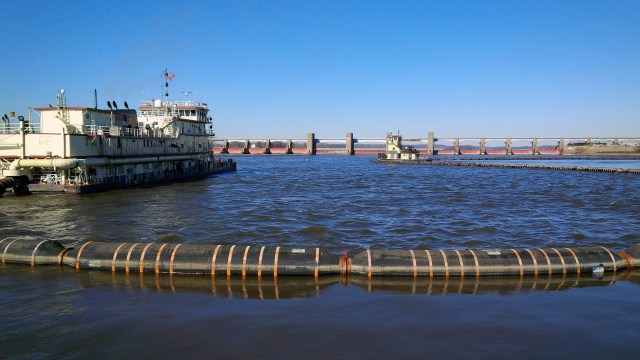 A picture of boats repairing a lock on the Mississippi River