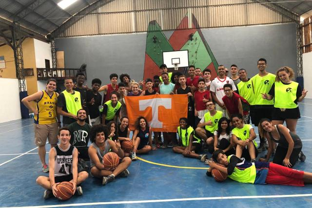 Ashleigh Huffman, assistant director of UT's Center for Sport, Peace, and Society, was invited by the State Department to spend a week leading clinics and workshops in Brazil. Huffman and basketball players from Minas Gerais pose for a group photo after a clinic.