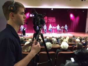 JEM student William Dowling operates a camera while live-streaming the gubernatorial candidate forum at the Nashville Public Library.