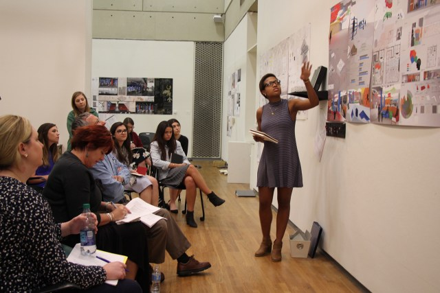 Andrianna Thompson, fourth-year Interior architecture student, presents her final project to a panel of visiting critics and students during spring semester 2017.