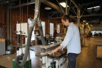 Niklos Toldi, School of Interior Architecture student, works on a belt sander in the Fab Lab.