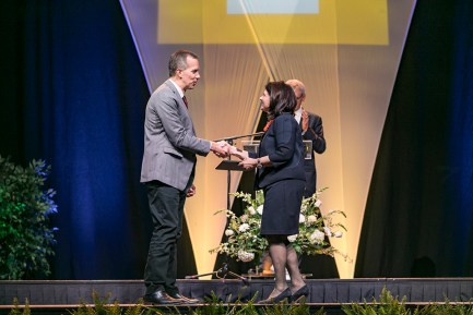 Outstanding students and faculty members are recognized during the Chancellor's Honor Banquet at the Knoxville Convention Center on Tuesday, April 17, 2018. Here, Brad Collett, left, winner of the Excellence in Academic Outreach award, is congratulated by Chancellor Beverly Davenport. Photo by Erik Campos 41234