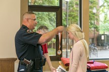 Soon-to-be UT graduates, who are also female military service veterans, received medallions, cords from UTK police chief Troy Lane and quilts from the Quilts of Valor group on Tuesday, May 8, 2018. Photo by Erik Campos