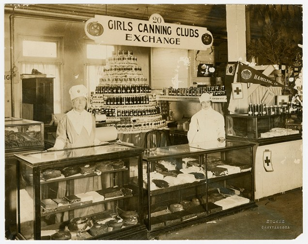Two Hamilton County canning club members with exhibit of canned produce and baked goods. Virginia P. Moore Collection, Special Collections, University of Tennessee Libraries.