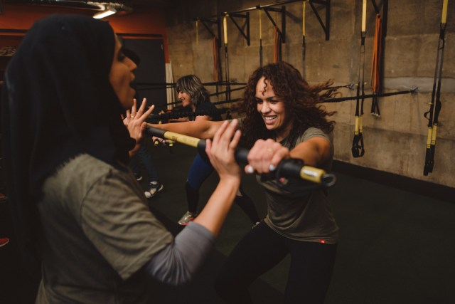 Aline Silva, an Olympic wrestler from Brazil, works with partner Malak Hasan, secretary general of the Palestinian Boxing Federation, during group fitness at Ambitious Athletics in Washington DC. Both women were participants in the 2017 GSMP: Empower Women through Sports exchange.