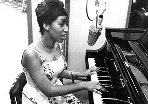 image of Aretha Franklin playing the piano