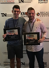 Matt Freels with Fowler receive their award at the Knox Film Festival.