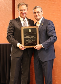 Stephen Land, 2018 CCI Donald G. Hileman Distinguished Alumni Award recipient (left) with CCI Dean Mike Wirth