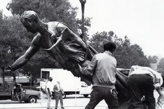 In October 1990, a gas explosion blew the statue off its base and broke off the hand holding the torch.