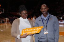 Shaina Destine, research assistant professor and humanities librarian, is recognized at a game at Thompson-Boling Arena on February 14.