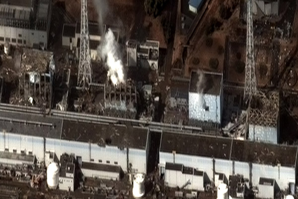 This satellite image from Digital Globe shows, from left, Fukushima reactors No. 4, 3, 2, 1 after the March 11, 2011 earthquake and following tsunami led to explosions and nuclear meltdowns in all but reactor No. 4. Two UT students and a professor visited the site in 2018.