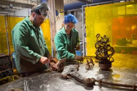 """Students in John Powers' Intermediate and Advanced Sculpture class use scrap metal to create sculptures for the sixth annual """"The Art of Recycling,"""" exhibition, which runs through April 21 at the Knoxville Convention Center."""