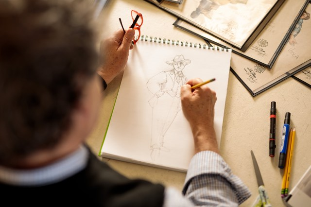 Bill Black, associate department head of the Department of Theatre and professor of costume design and technology, sketches a design for The Real Inspector Hound in the Clarence Brown Theatre workshop. Photo by Steven Bridges