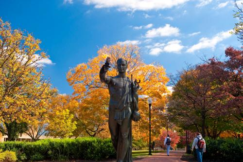 The Torchbearer Statue on a beautiful fall day