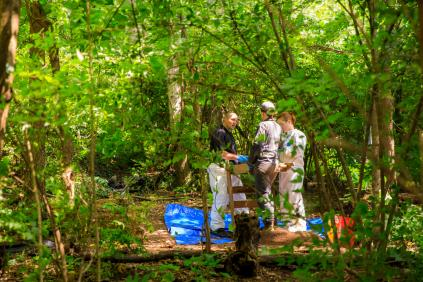 Law enforcement officers work on a burial excavation at the Anthropology Research Facility (also known as the Body Farm) on June 13, 2019. Photo by Steven Bridges/University of Tennessee.