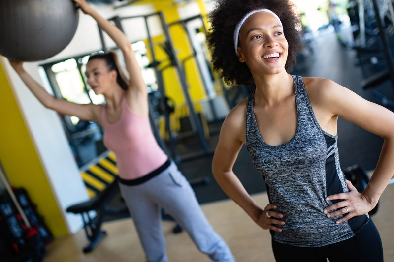 Beautiful fit women exercising together in gym