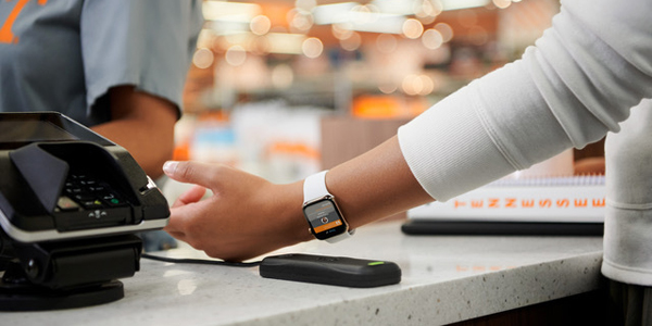 Image of a student using the Apple Watch for the Mobile VolCard