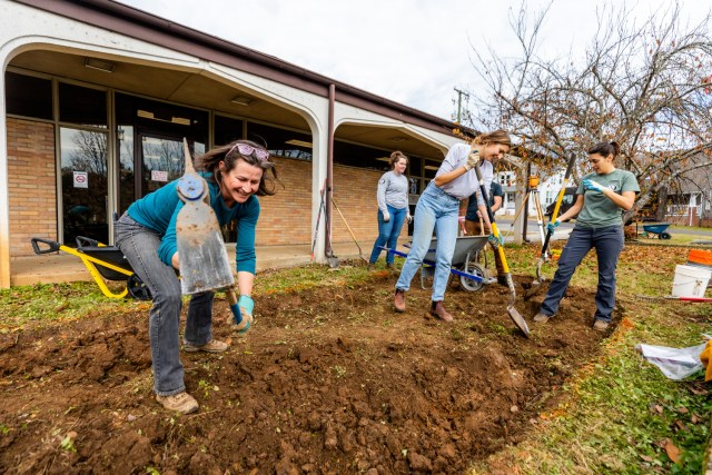 helps build a rain garden at the North Knoxville Branch, Knox County Public Library, in the Edgewood Park neighborhood of Knoxville
