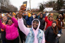 UT students take selfies while marching in the Knoxville Martin Luther King Jr parade with other UT faculty, and staff on January 20, 2020. Photo by Steven Bridges/University of Tennessee.
