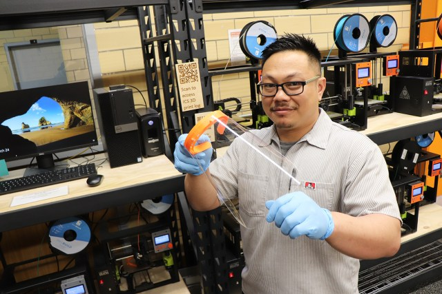 Tom Duong, staff supervisor in the Tickle College of Engineering's Innovation and Collaboration Studio, has 20 machines running to print headbands for face masks.